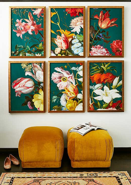 Large-scale paintings in fabulous colors, like these from Lillian August, brighten up an entryway. Benton Ottomans in Mustard Yellow ground the scene in a warmer color scheme.