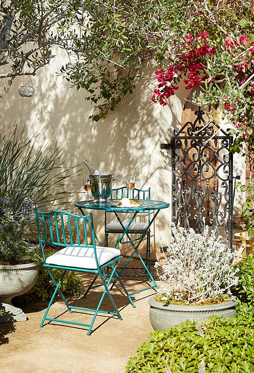 Since it easily folds up to store when not in use, a petite bistro set is a perfect entertaining solution for small outdoor spaces.