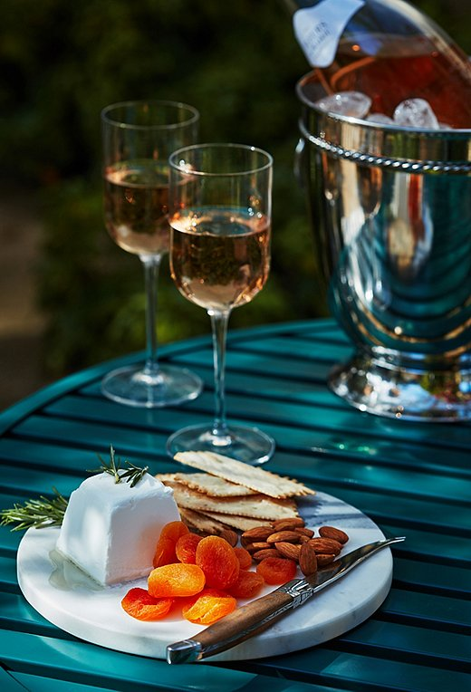 Cheese, crackers, dried fruit, nuts: When it comes to outdoor entertaining, we think simpler is better. A stylish wine bucket means you won't have to dash indoors for refills.