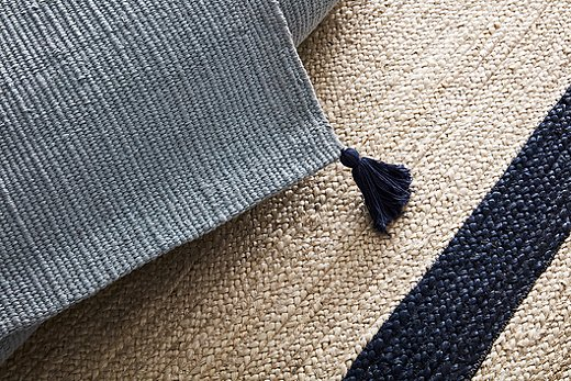 Many of the Open House rugs sport tassels on their corners. All are woven of either jute or jute and cotton, jute being the softest of the natural fibers used for floor coverings.