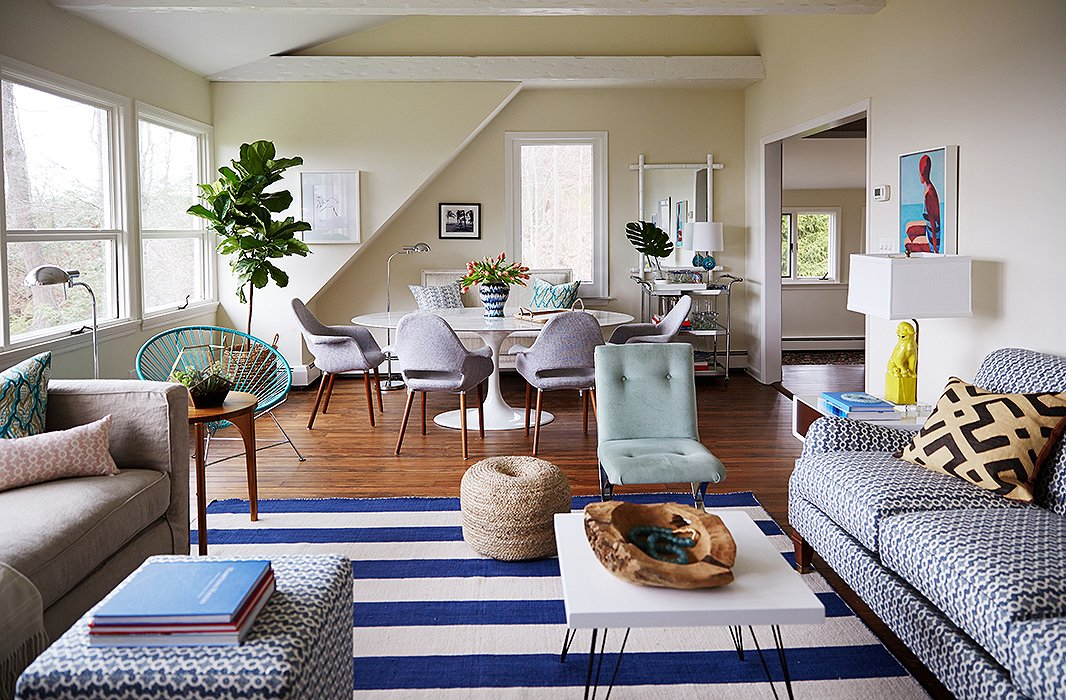 To keep the beach house feeling beachy casual, Alex used outdoorsy blues and greens plus touches of organic materials including sisal and raw wood.