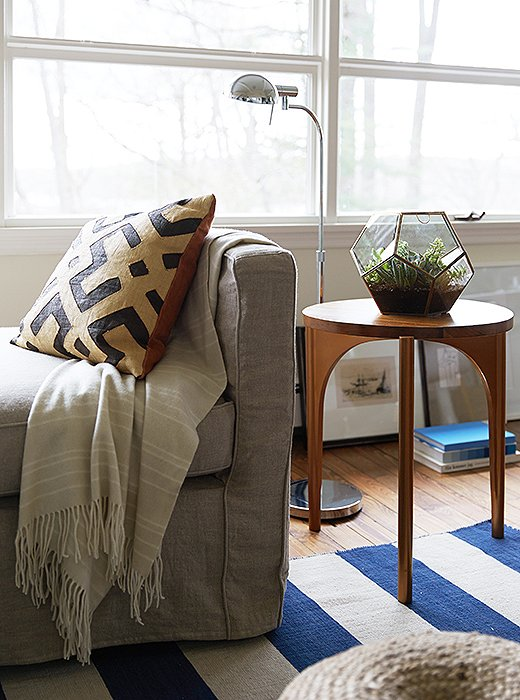 Well-placed side tables ensure that a spot to set down a glass is within arm's reach.