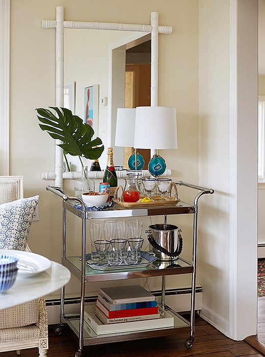 A bar cart isn't just convenient; when used as a showcase for pretty objects and barware, it's also a great way to add eye-catching shine to a room.