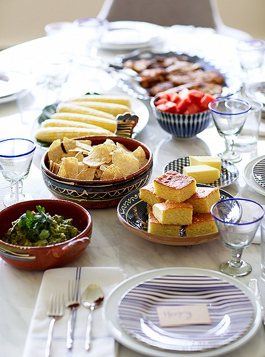 A mix of new blue-and-white basics and vintage finds makes for an inviting table setting.