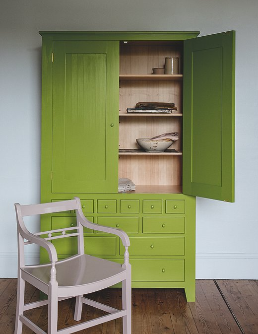 This vignette features three of Plain English's new colors: the cupboard is painted in Moygashel, the wall in Cotton Pinny, and the chair in Mouldy Plum.