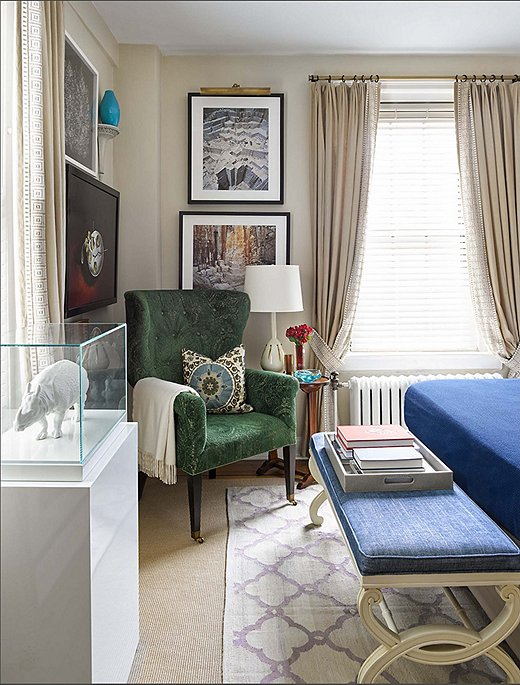 "Like the rest of the apartment, the bedroom is filled with pieces from Philip and Mark's vast art collection. The porcelain Nymphenburg rhinoceros housed in an acrylic case is a particular favorite. ""It's a traditional old thing treated like a modern sculpture,"" Philip says."