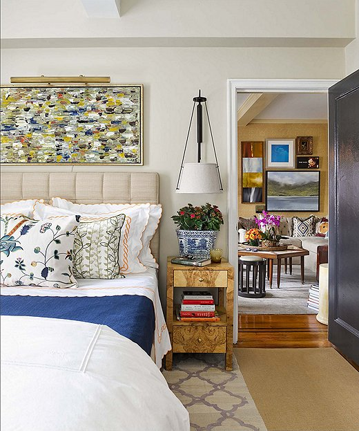 Philip and Mark maximized space in the bedroom by implementing storage under the bed and using bedside tables with drawers. Instead of having lamps take up room on the nightstands, the bed is framed by twin sconces.