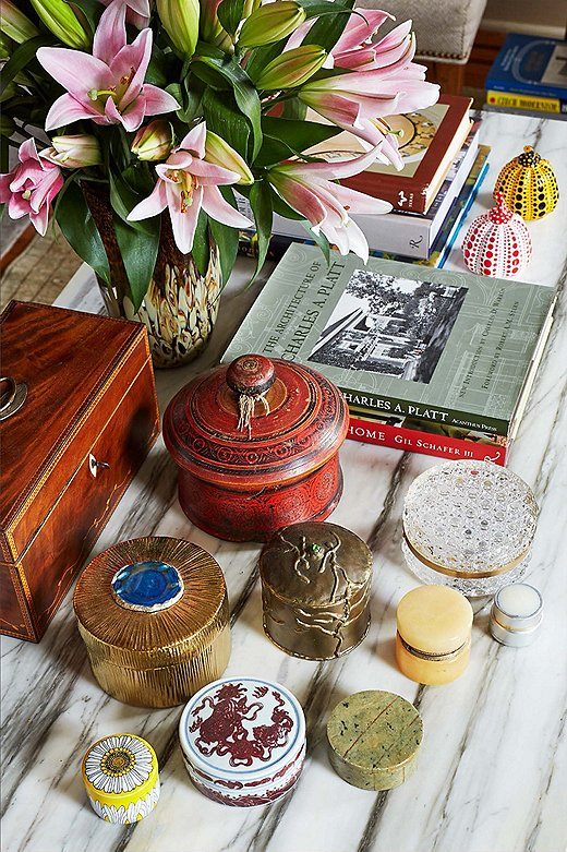 English marquetry and trinket boxes, along with a pair of Yayoi Kusama lacquered pumpkins, fill the coffee table in the living room. Occasionally Philip will clear everything off and use the table as a drawing board, since the room receives plenty of light.