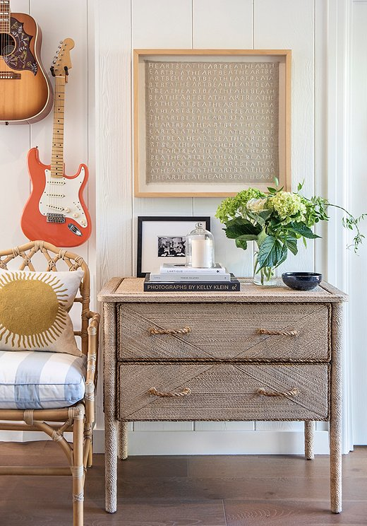 """Thehusband, a musician, collects guitars. Marea chose to hang the guitars to free upspace and add visual interest. """"We pickedthe ones that worked best with out color palette,"""" shesays with alaugh."""