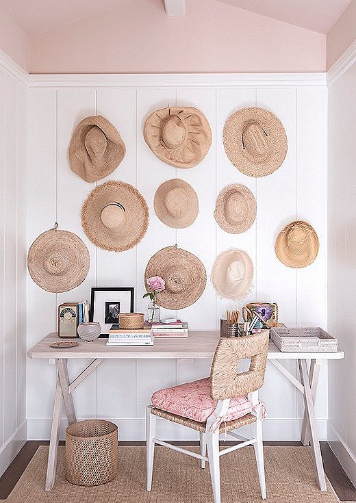 """Marea hung a collection of hats on the wall in one of the guest rooms, dubbed the Pink Room. """"It turned out to be this beautiful installation that adds texture,"""" says Marea."""