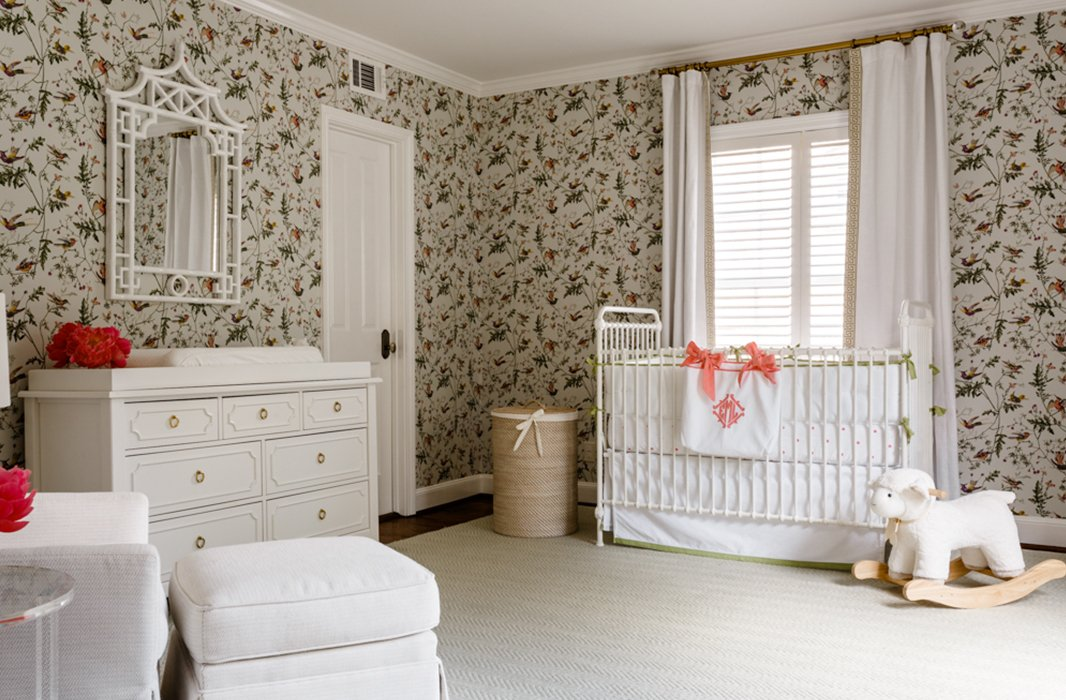In the nursery, all-white furniture picks up on the light and airy feel found throughout the rest of the home.
