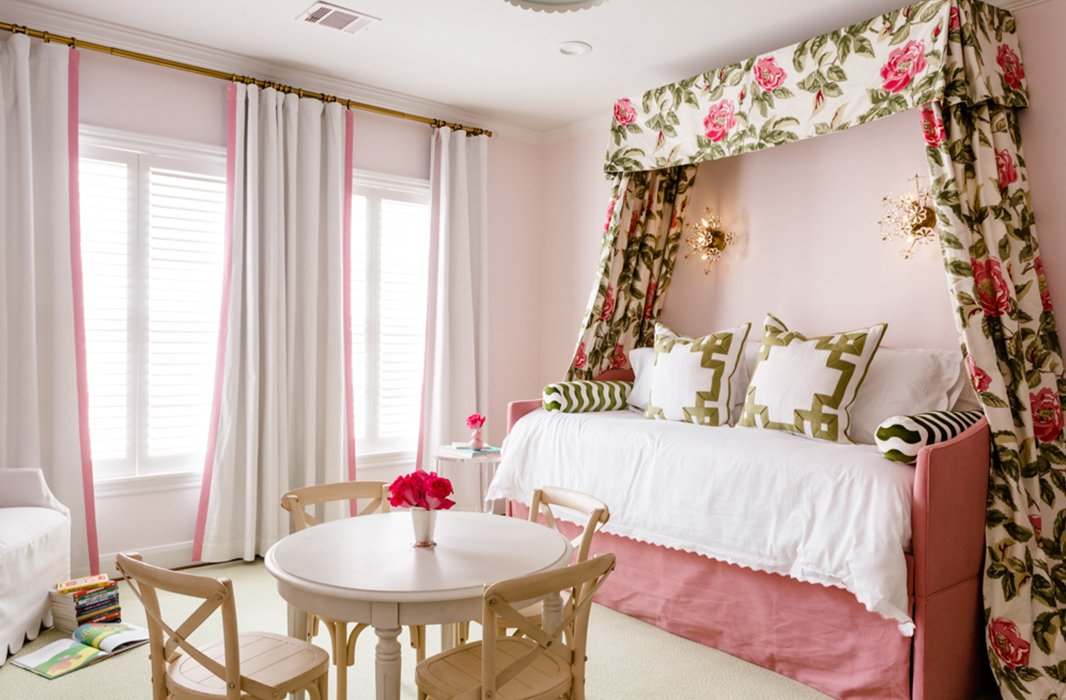 Acanopyof floral fabric frames a trundle bed in a kid's bedroom. All of the upholstery was sealedfor enhanced durability.