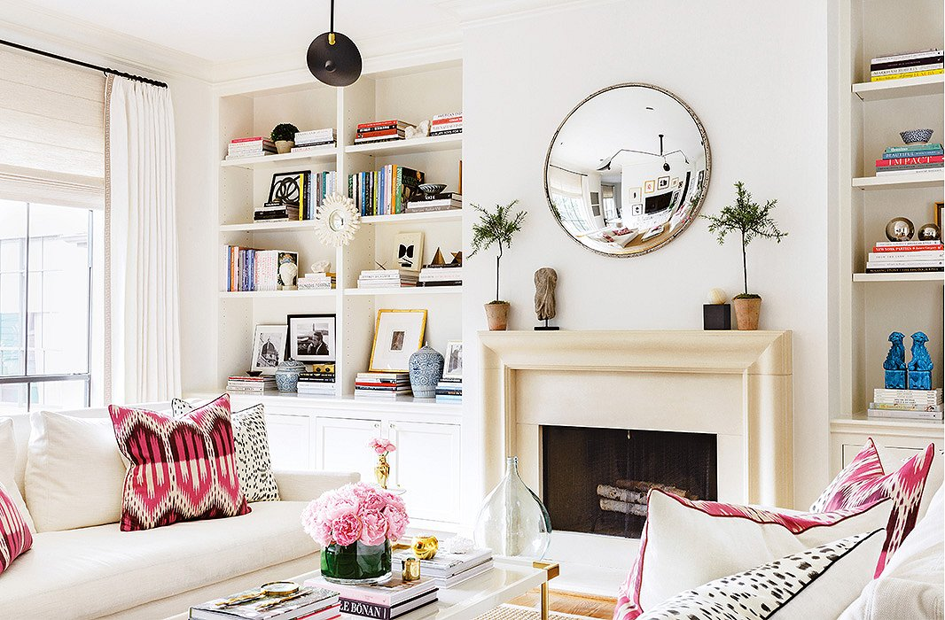 A living room with bookshelves styled to a T.
