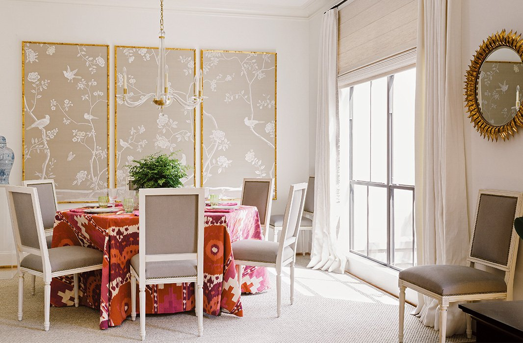 Framed panels of de Gournay wallpaper punctuate Paloma's dining room.