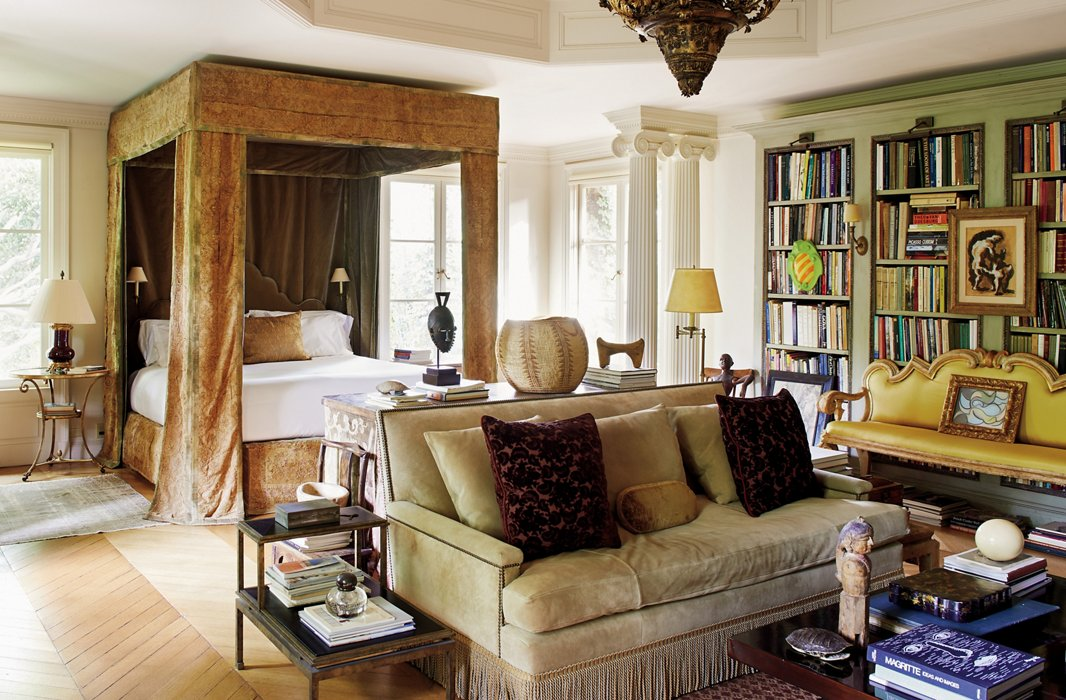 Richard's master bedroom is also arranged to be a library and living space, with floor-to-ceiling bookcases and a sumptuous sofa.
