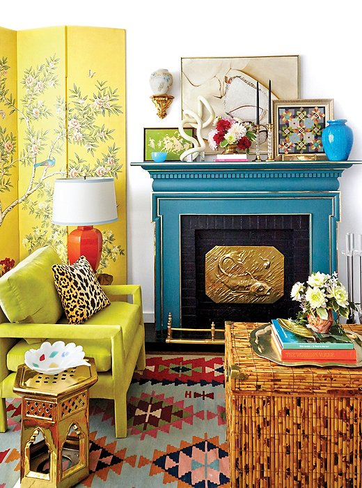 In his Manhattan home office, Eddie brought together an unlikely mix of vintage finds that play up his vibrant aesthetic—from the Parsons chair that he reupholstered in chartreuse velvet to the chinoiserie screen.