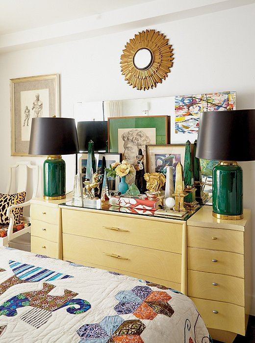 The pair of 1980s green lamp bases were a thrift-shop find by Eddie, who revived them with sleek black shades.