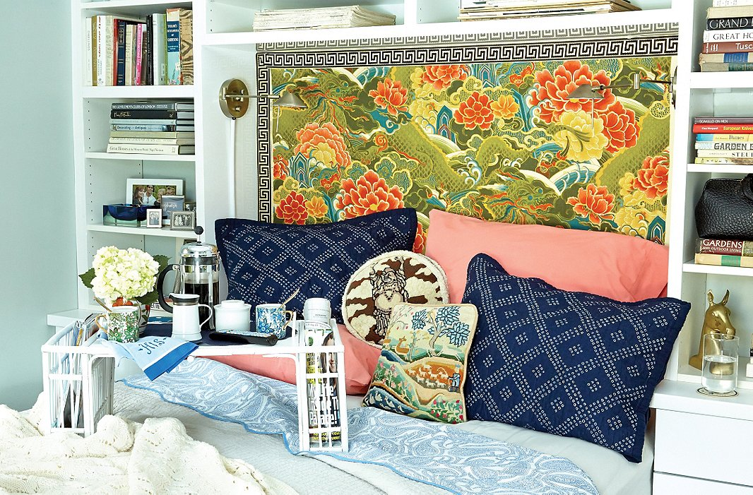 Eddie repurposed a piece of vintage chinoiserie textile for his headboard and then channeled its blues and salmon color for the pillows.