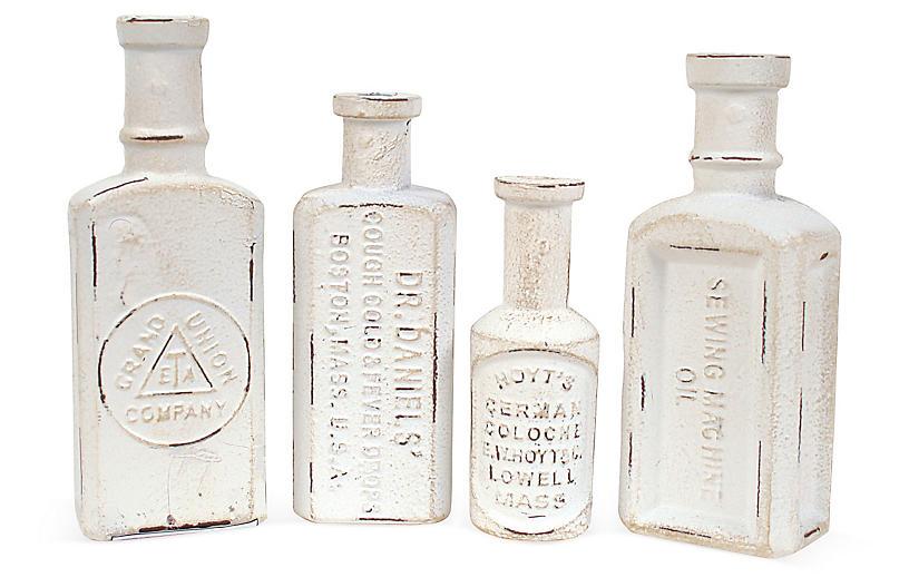 Asst. of 4 Distressed Cast-Iron Bottles