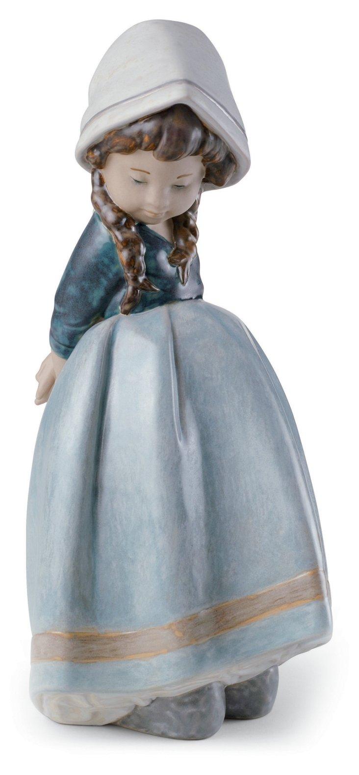 Pensive Blue Figurine