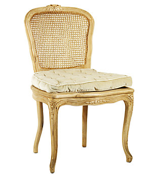 A caned Rococo side chair with a loose