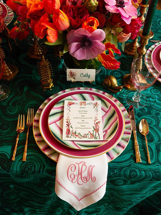 A wild mix of flowers and patterns makes this Eclectic table come alive. Photo courtesy of Catherine Austin.