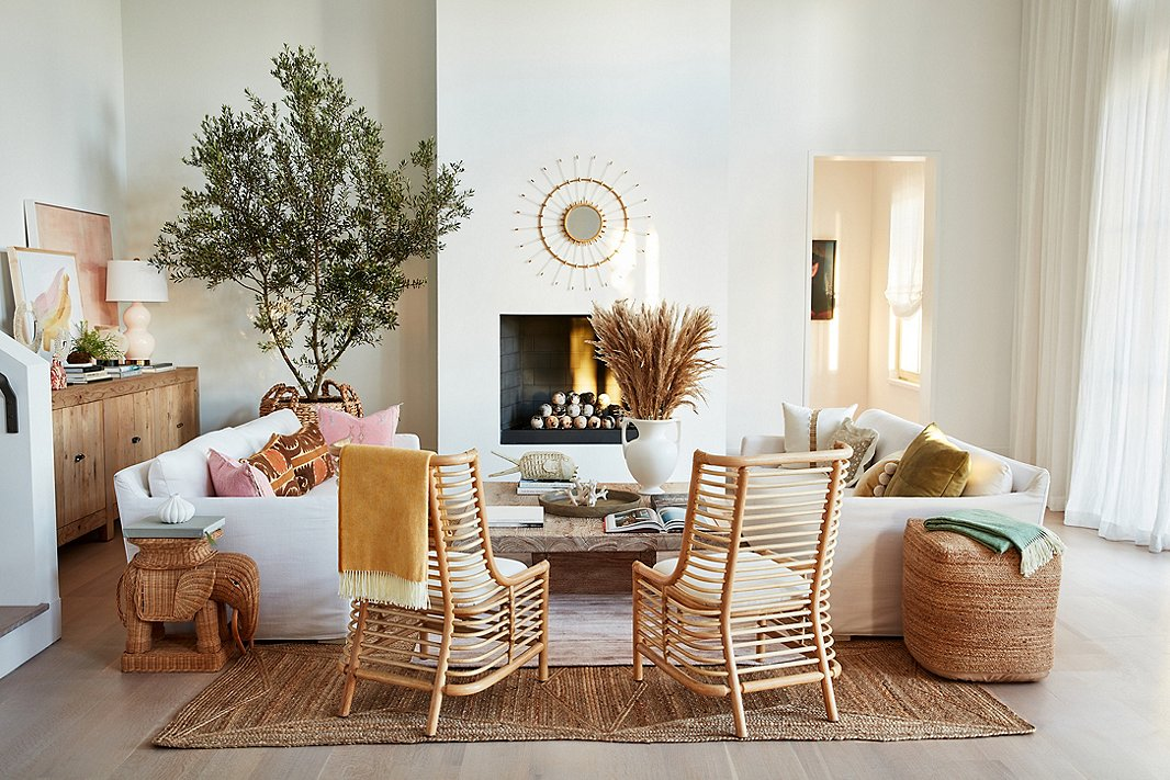 Organic, yes, but also sophisticated, thanks to the sleek lines of the rattan Sienna chairs and the Liza slipcovered sofas. The Snyder rattan elephant side table contributes both whimsy and global chic.