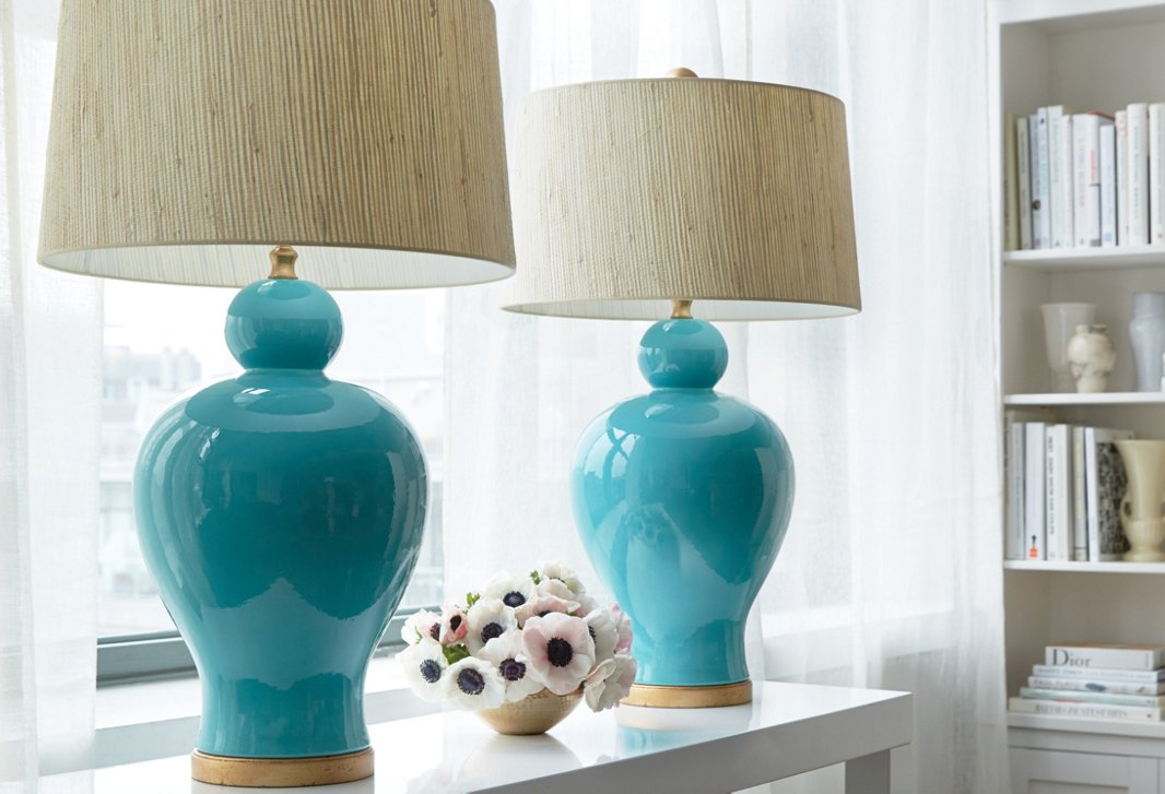 A pair of Bradburn Home table lamps beautifully anchor a console table.