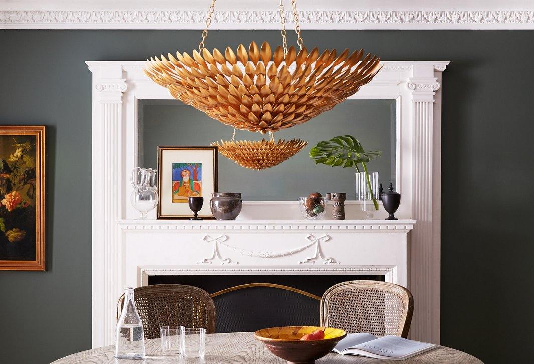 Crystorama's Broche series of ceiling mounts, chandeliers, and sconces features wrought-iron detailing in a variety of finishes, including silver, white, and gold (shown above).