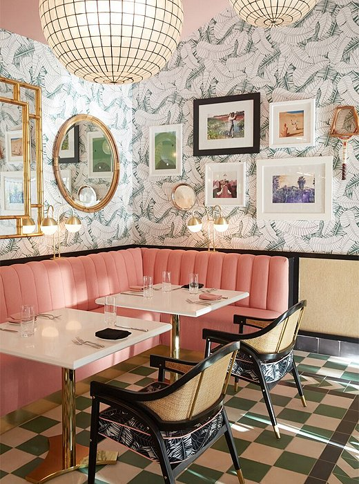 Pink velvet banquettes sit against Martyn's banana-leaf wallpaper.