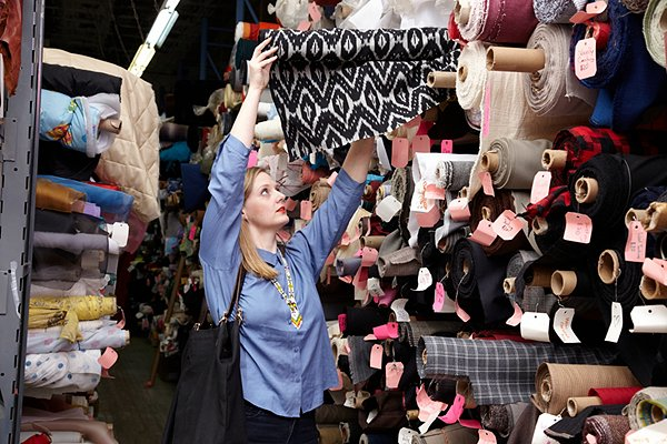 Me exploring the options at Jem Fabric Warehouse in New York. Sometimes the best fabrics are not the most conveniently placed, so don't overlook those high shelves.
