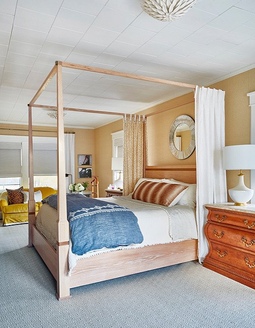 The whitewashed wood bed frame speaks perfectly to that Swiss modernism that Virginia loves so much.