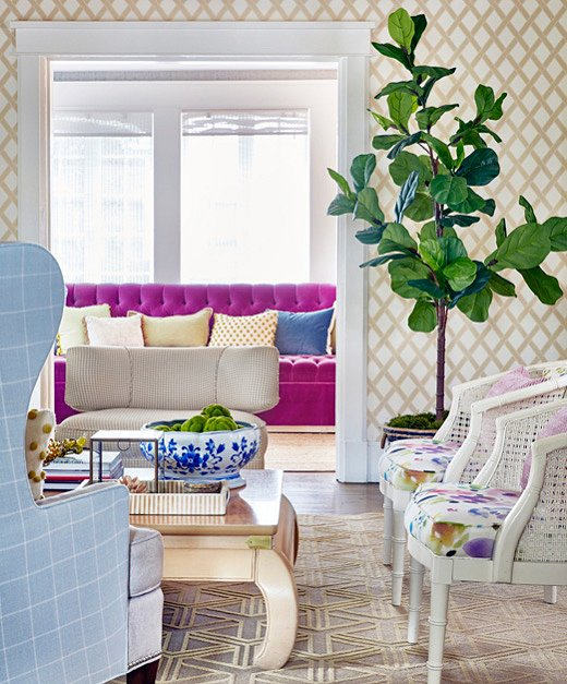 Virginia pulled the same purple from the living room chairs to a sofa in an adjacent sitting room. Continuing the color story throughout the house makes things feel cohesive.