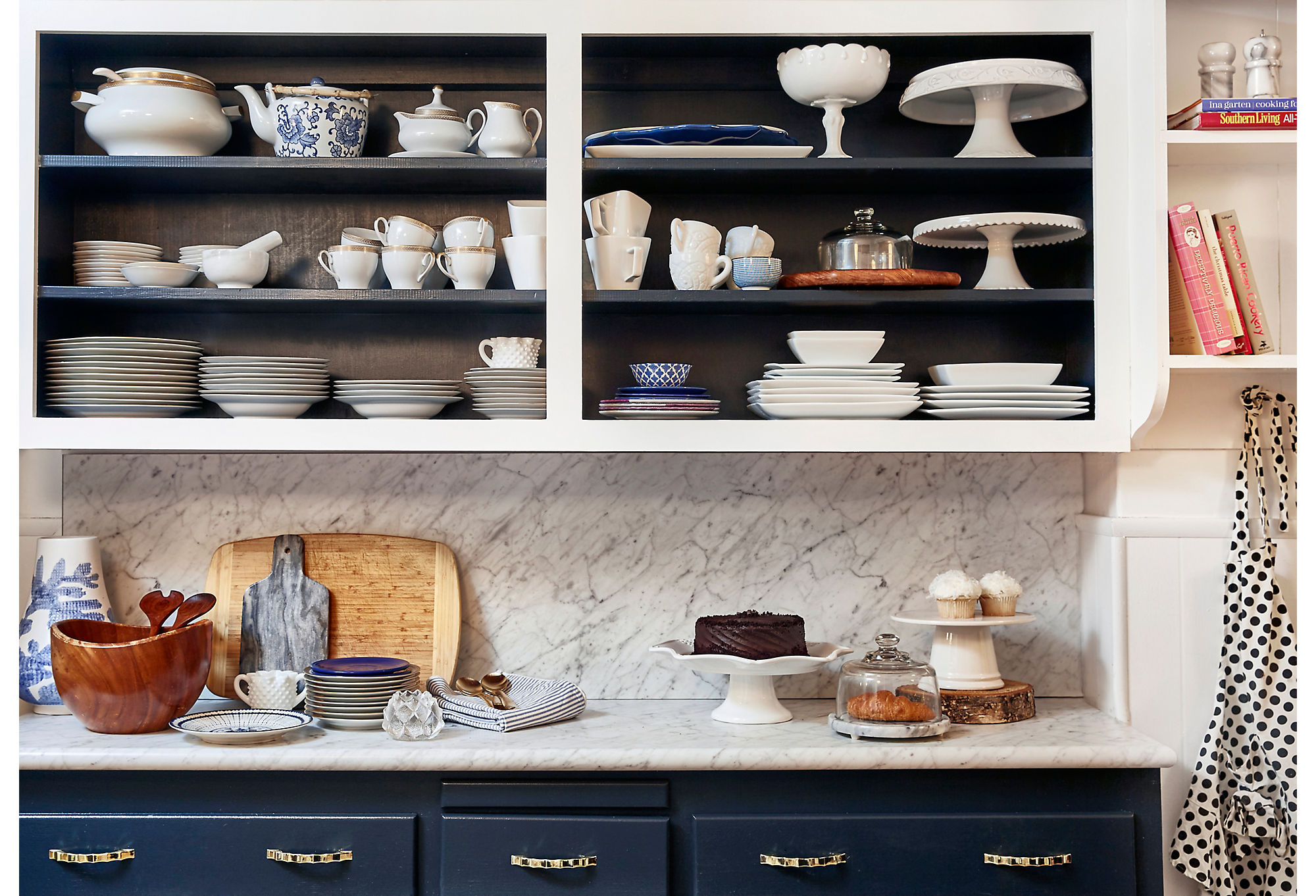 Virginia went for a classic palette of blue and white in the kitchen. She used open shelving to display her sets of tableware.