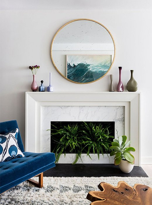 Geometry at play: A round mirror (similar to the Kylie wall mirror) softens the living room's squared-off mantel.