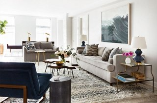A Gray Love Seat Complements A Sofa Upholstered In A Similar Hue And A Blue  Midcentury