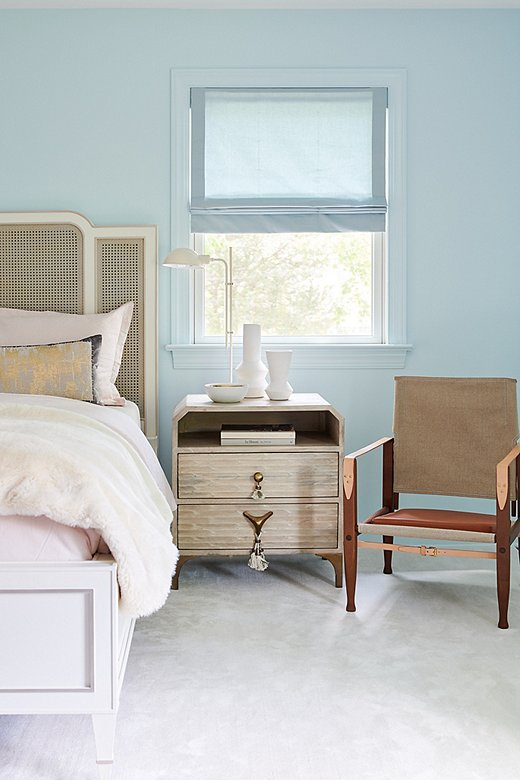The guest room was designed for the grandmother of one of the clients. Thecaned bed exudes a sweet, traditional feel, while the whimsical nightstand and the safari chair are classic in a more modern sense.