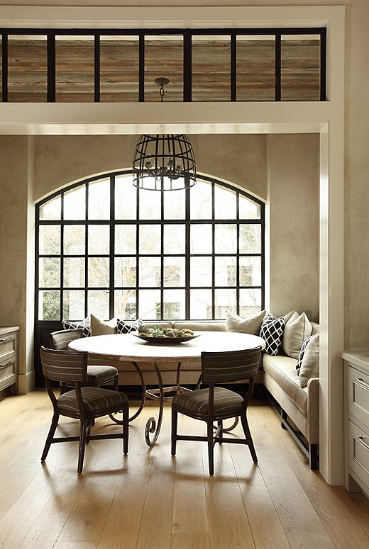 The breakfast room, which is theirusual dining spot, was made to feel like an enclosed porch, according to Tish. Architect Keith Summerour installed his signature steel windows to let in natural light.