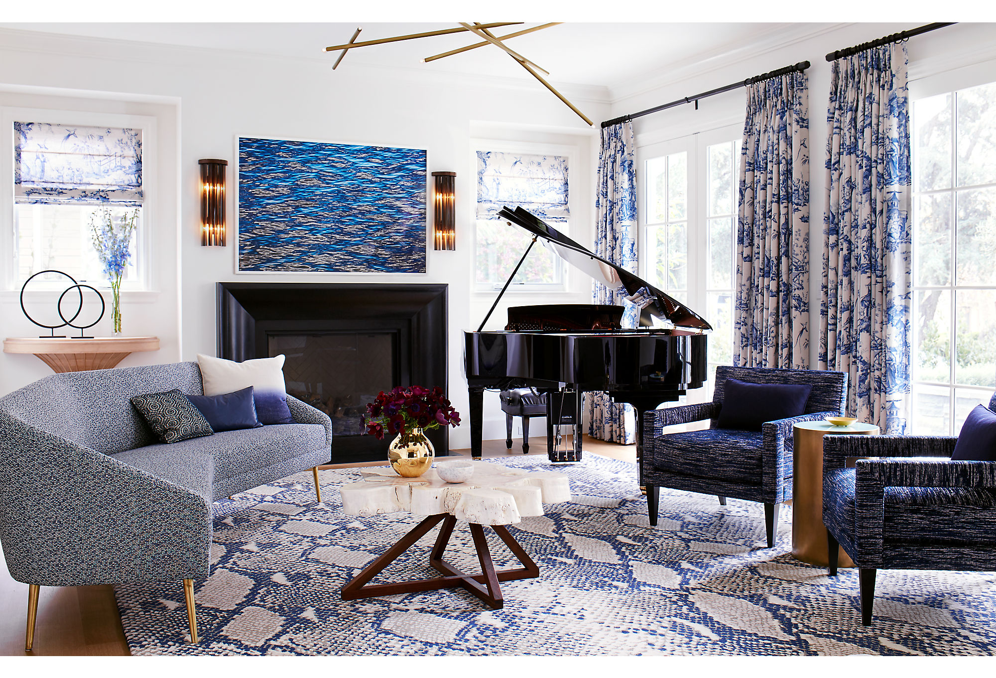 Adam wanted to do a traditional blue-and-white color scheme in the house, but he wanted to do it his way. The wild mix of pattern and color in the space plays on his love of eclecticism and vibrancy while remaining rooted in a traditional palette. The baby grand piano adds a classic note to the atmosphere.