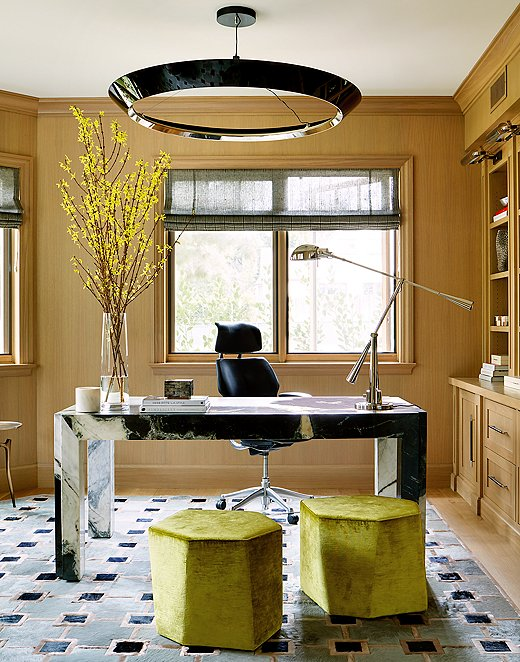 Adam wanted to play off the elegance of New York's Chrysler and Empire State Buildings in this room. He went for traditional leather chairs, a marble desk in a modern silhouette, and chrome accessories to round out the Art Deco vibe.