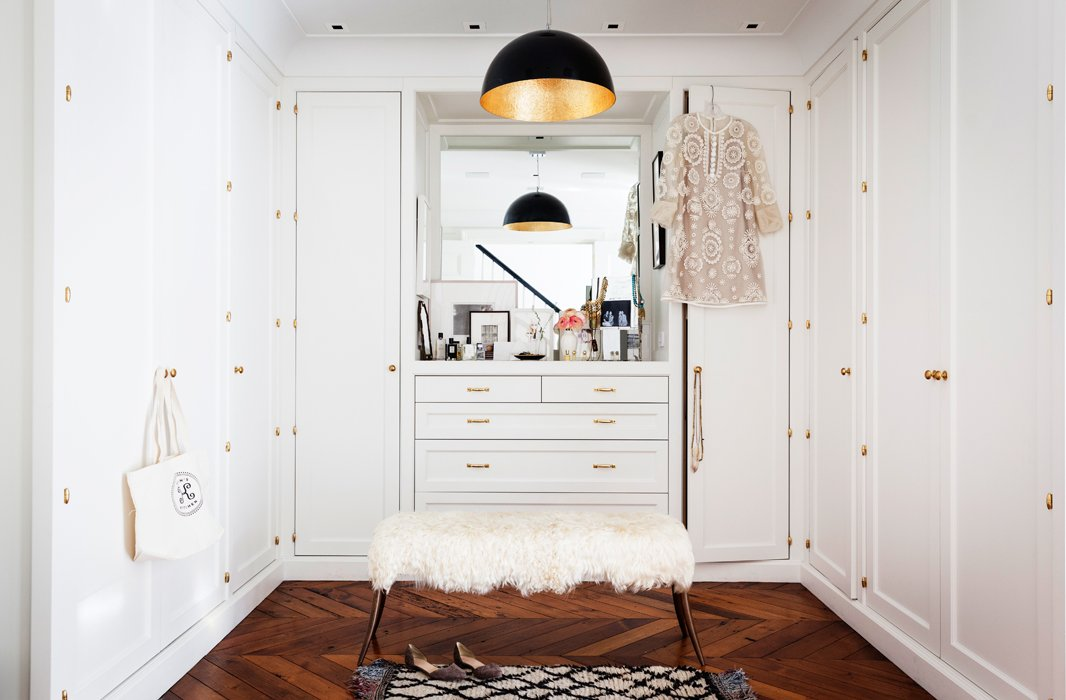 For her dressing room, Alison chose a black-and-white scheme, brightened by flashes of brass in the hardware and the lighting.