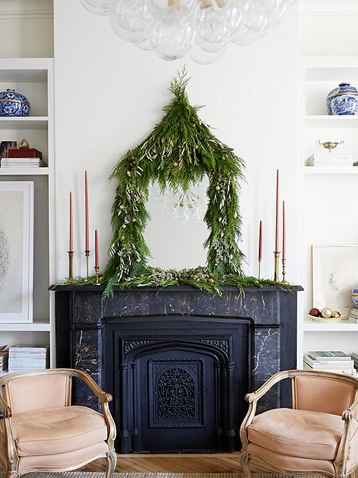 If you're looking for a more hands-on approach, try out this DIY, which uses sprigs of fresh greenery to create a festive frame around a mirror. Photo by Manuel Rodriguez.