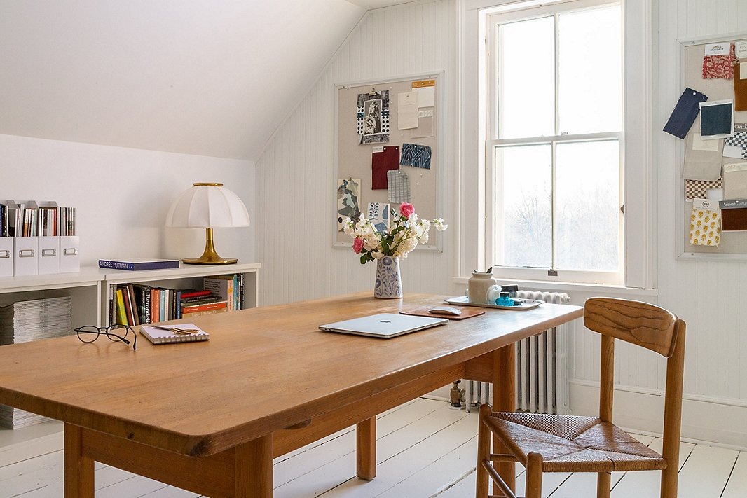 The formerly unfinished attic is now the Richters' home office. White paint and pale wood furnishings have transformed it into a bright, inviting space.