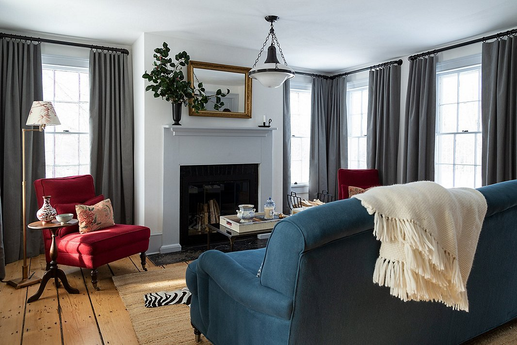 """The sitting room is the oldest part of the house. """"We wanted to play with traditional motifs and antiques but experiment with color, textile layering, and customizing,"""" says Keren."""
