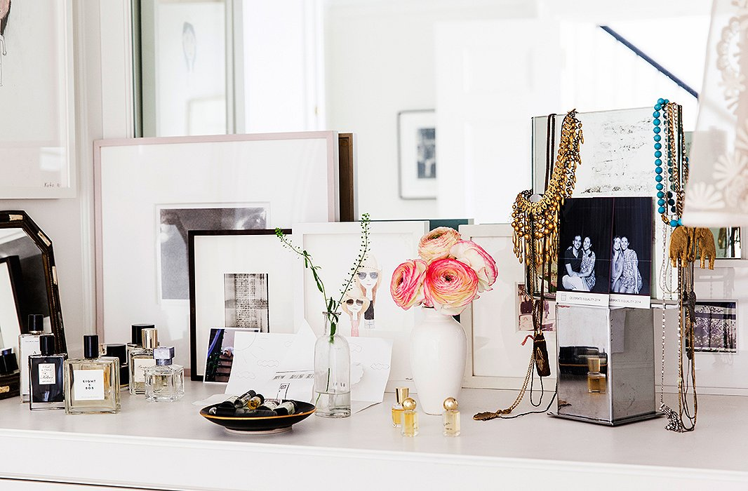 The vanity is as curated as the rest of the house, with photographs of friends and a three-dimensional artwork by her daughter.