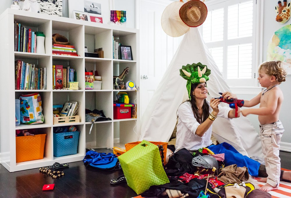 A favorite pastime with the kids? Playing superhero dress-up. Tate gets a hand from Allison for his transformation in front of Judah's ultimate hideout: his tepee.