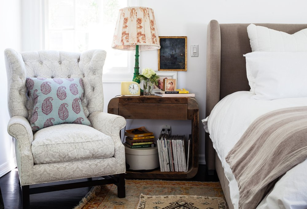 "The faded gray-and-white damask chair ""came with the marriage,"" jokes Allison, but the addition of a bold paisley pillow makes for a modern-feeling pattern mashup."