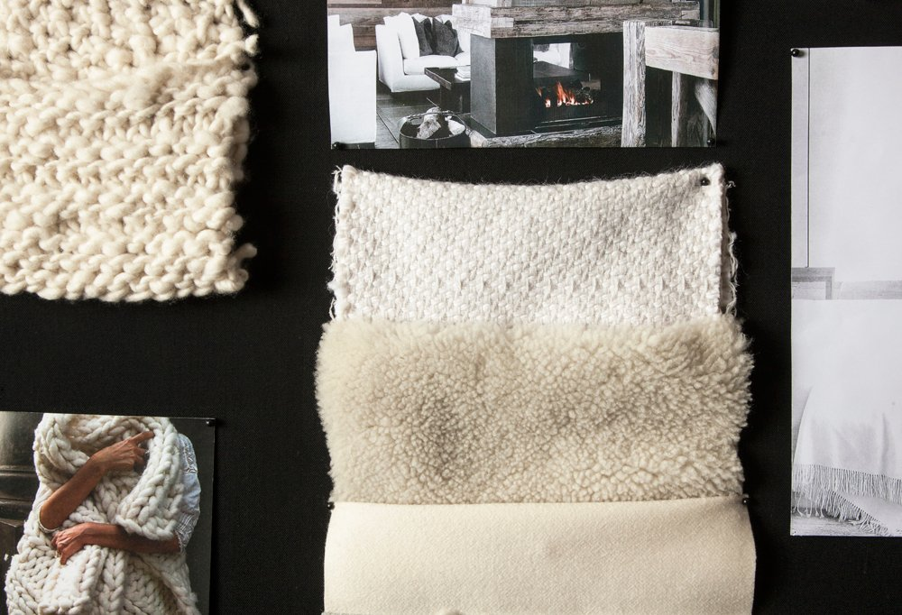 A mood board full of neutral knit samples, some of which were knit on the subway by one of the team's designers.