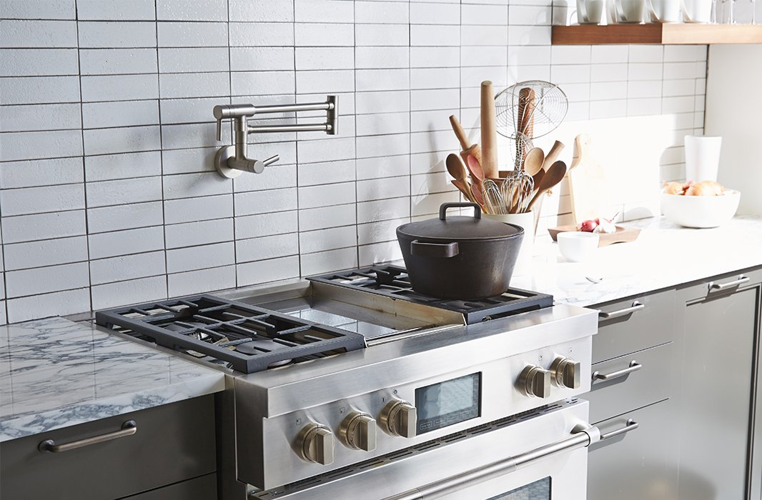 Every serious cook's dream: a pot-filler faucet by Moen plus an industrial-quality Jenn-Air stove constructed to handle a heavy-duty pot.