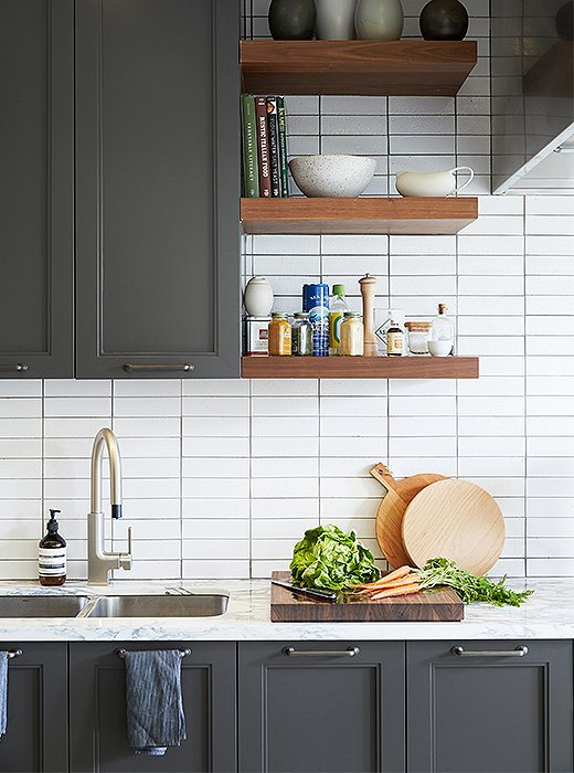 Open shelving (custom made by the architectural firm Gensler) provides easy access to frequently used ingredients (and pretty objects), freeing up counters.